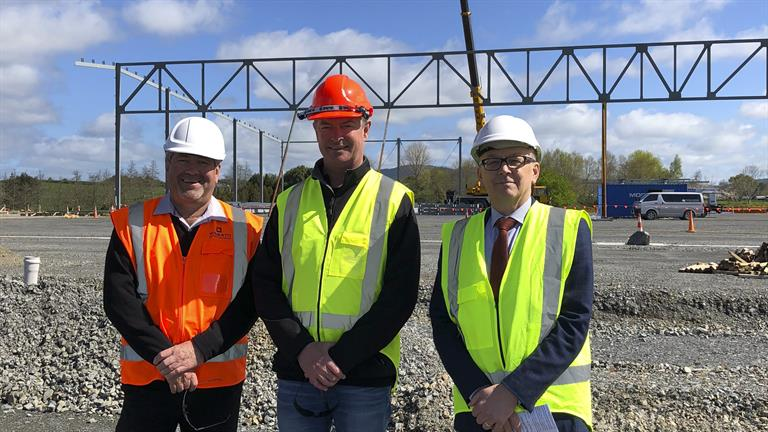 Mayor Allan Sanson (left), Ports of Auckland CEO Tony Gibson and Waikato District Council GM Community Growth Clive Morgan check out the warehouse facility under construction for Open Country Dairy at the Waikato Freight Hub at Horotiu.